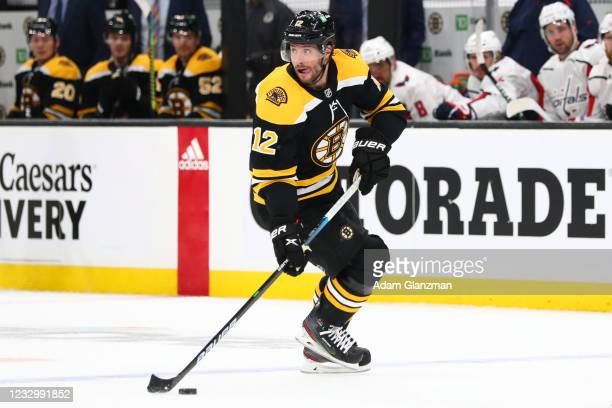 Craig Smith of the Boston Bruins skates with the puck in Game Three of the First Round of the 2021 Stanley Cup Playoffs against the Washington...