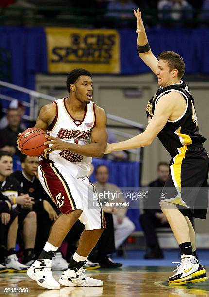 Craig Smith of the Boston College Eagles looks to play the ball against Adrian Tigert of the WisconsinMilwaukee Panthers during the second round of...
