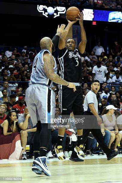 Craig Smith of the Enemies attempts a shot while being guarded by Carlos Boozer of the Power in the first half during week seven of the BIG3 three on...