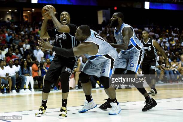 Craig Smith of the Enemies dribbles the ball while being guarded by Glen Davis of the Power in the first half during week seven of the BIG3 three on...