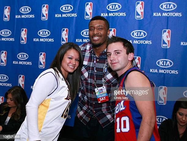 Craig Smith of the Los Angeles Clippers poses with fans during an appearance at the Kia MVP Court at Jam Session presented by Adidas during NBA All...
