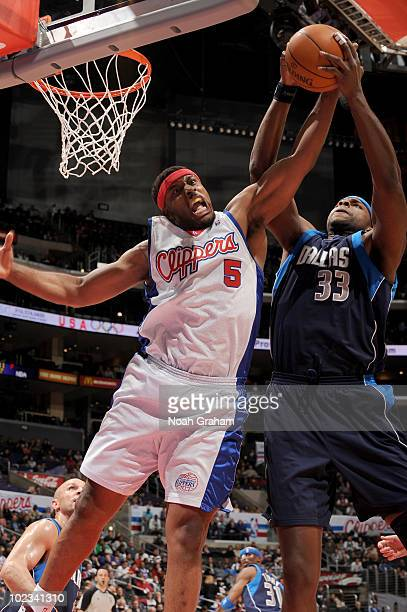 Craig Smith of the Los Angeles Clippers tries to get control of the ball from Brendan Haywood of the Dallas Mavericks at Staples Center on April 12...