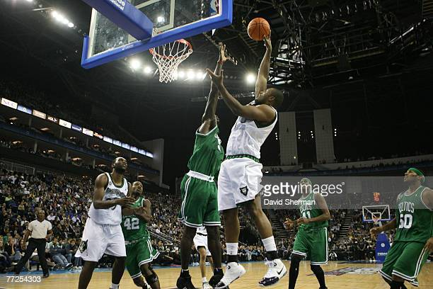 Craig Smith of the Minnesota Timberwolves goes to the basket against Kevin Garnett of the Boston Celtics in the O2 Arena in London during NBA Europe...