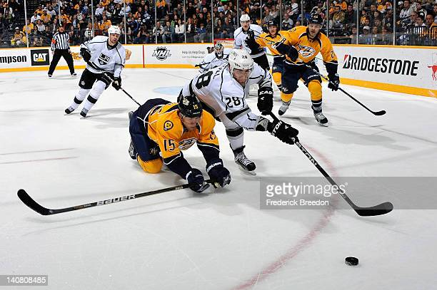 Craig Smith of the Nashville Predators dives for a puck in front of Jarret Stoll of the Los Angeles Kings at the Bridgestone Arena on March 6 2012 in...