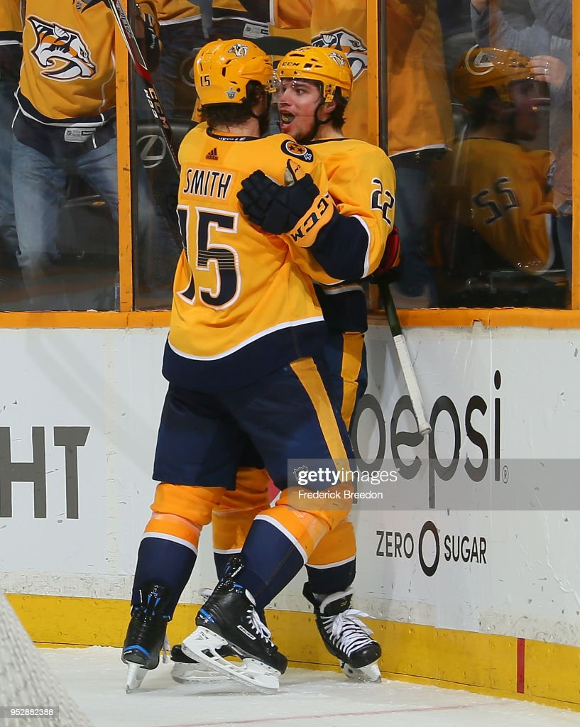 Craig Smith #15 of the Nashville Predators embraces teammate Kevin Fiala #22 as he reacts after scoring the game winning goal in the second period of overtime in a 5-4 Predators victory in Game Two of the Western Conference Second Round during the 2018 NHL Stanley Cup Playoffs at Bridgestone Arena on April 29, 2018 in Nashville, Tennessee.