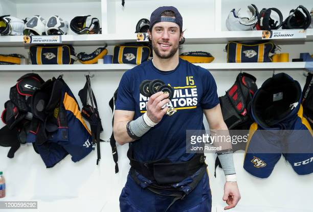 Craig Smith of the Nashville Predators holds his hat trick pucks after a 5-0 win against the New York Islanders at Bridgestone Arena on February 13,...