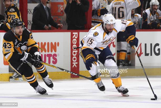Craig Smith of the Nashville Predators is chased by Conor Sheary of the Pittsburgh Penguins during the first period of Game One of the 2017 NHL...