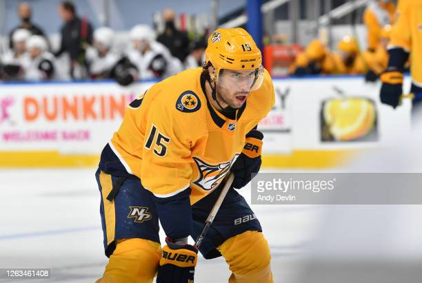 Craig Smith of the Nashville Predators lines up in position in the second period of Game One of the Western Conference Qualification Round against...