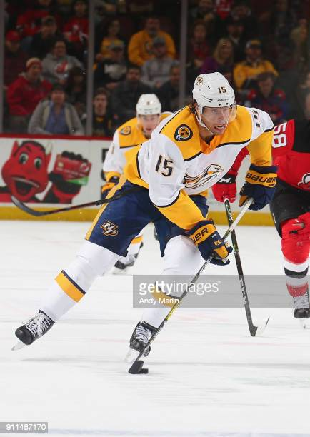 Craig Smith of the Nashville Predators plays the puck against the New Jersey Devils during the game at Prudential Center on January 25 2018 in Newark...