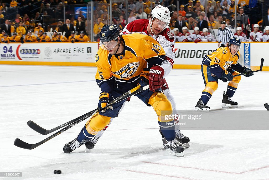 Craig Smith #15 of the Nashville Predators protects the puck against Shane Doan #19 of the Phoenix Coyotes during an NHL game at Bridgestone Arena on April 10, 2014 in Nashville, Tennessee.