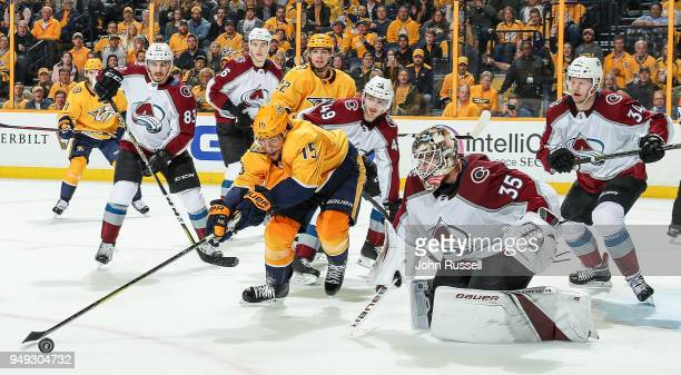 Craig Smith of the Nashville Predators reaches for a loose puck against Andrew Hammond of the Colorado Avalanche in Game Five of the Western...