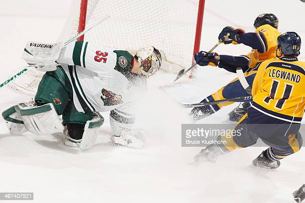 Craig Smith of the Nashville Predators scores a goal against Darcy Kuemper of the Minnesota Wild during the game on February 6 2014 at the Xcel...
