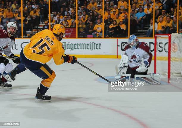 Craig Smith of the Nashville Predators shoots wide of goalie Jonathan Bernier of the Colorado Avalanche during the first period in Game One of the...