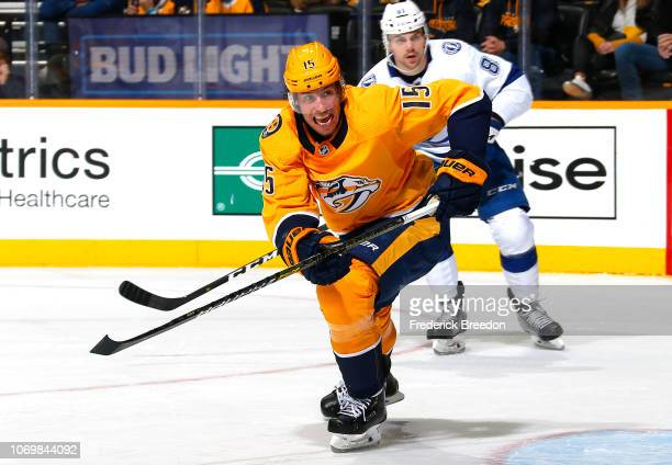 Craig Smith of the Nashville Predators skates against Erik Cernak of the Tampa Bay Lightning during the first period at Bridgestone Arena on November...