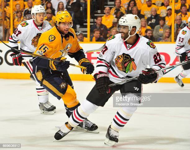 Craig Smith of the Nashville Predators skates against Johnny Oduya of the Chicago Blackhawks during the first period in Game Three of the Western...