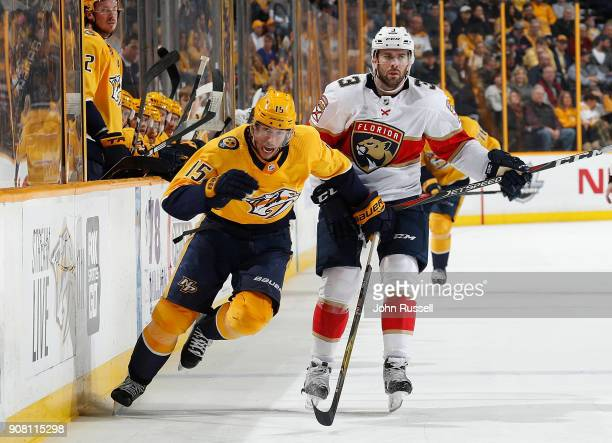 Craig Smith of the Nashville Predators skates against the Keith Yandle of the Florida Panthers during an NHL game at Bridgestone Arena on January 20...