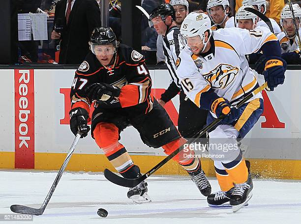 Craig Smith of the Nashville Predators skates with the puck against Hampus Lindholm of the Anaheim Ducks during Game One of the Western Conference...