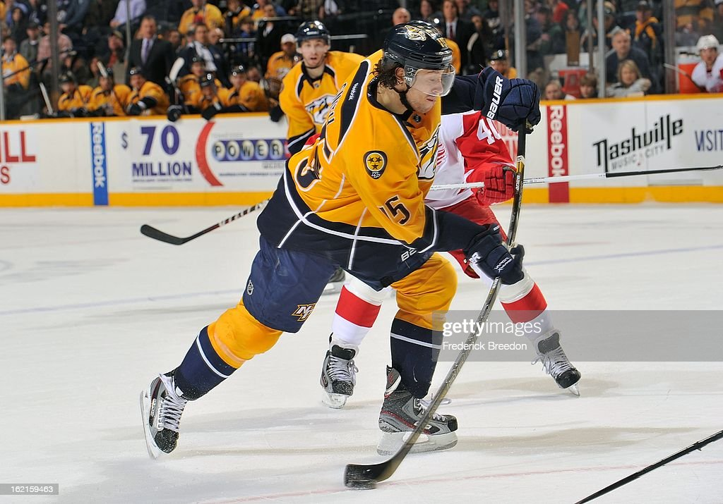 Craig Smith #15 of the Nashville Predators takes a shot against the Detroit Red Wings at the Bridgestone Arena on February 19, 2013 in Nashville, Tennessee.