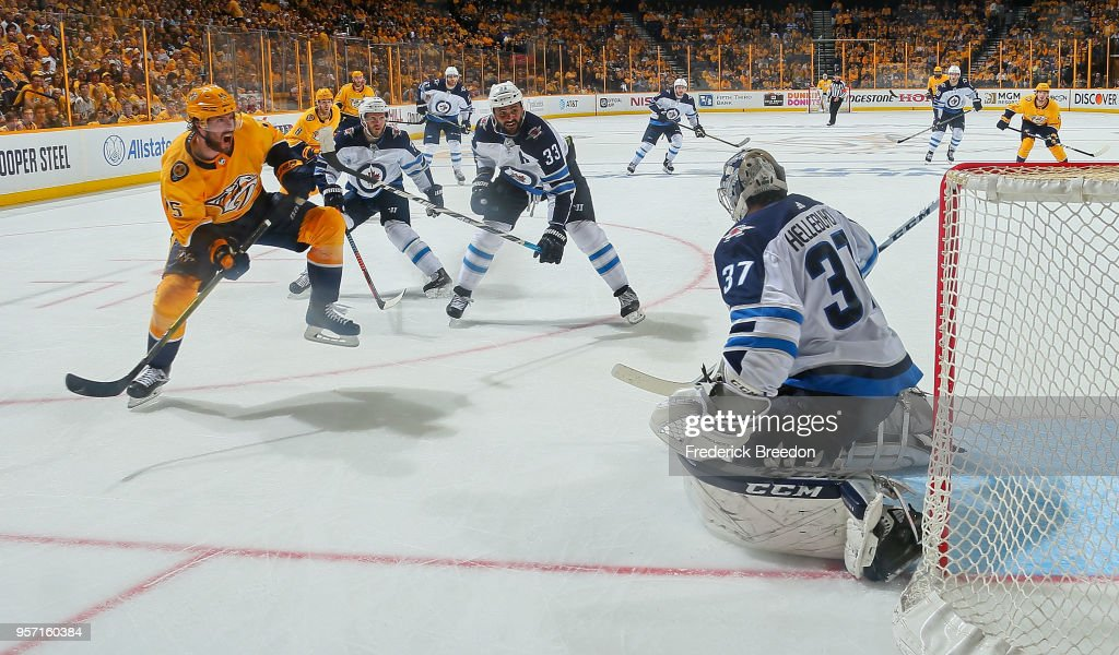 Craig Smith #15 of the Nashville Predators takes a shot on goalie Connor Hellebuyck #37 of the Winnipeg Jets during the third period of a 5-1 Jets victory in Game Seven of the Western Conference Second Round during the 2018 NHL Stanley Cup Playoffs at Bridgestone Arena on May 10, 2018 in Nashville, Tennessee.