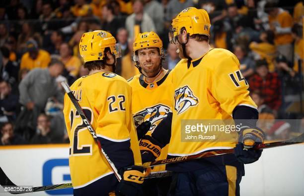 Craig Smith talks with Mattias Ekholm and Kevin Fiala of the Nashville Predators during an NHL game against the Winnipeg Jets at Bridgestone Arena on...