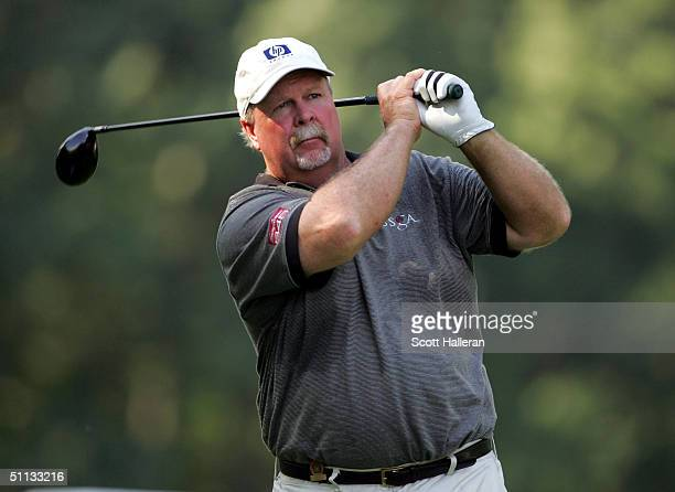 Craig Stadler hits his tee shot on the 15th tee during the second round of the 25th US Senior Open at Bellerive Country Club on July 31 2004 in St...