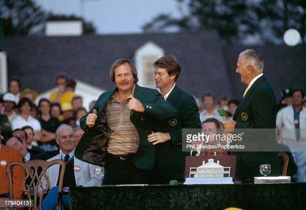 Craig Stadler of the United States is presented with the Green Jacket by Tom Watson after winning the US Masters Golf Tournament held at the Augusta...