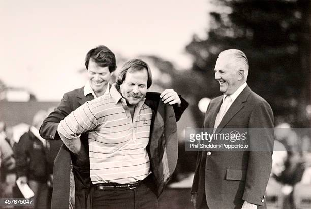 Craig Stadler of the United States receives the Champion's green jacket from former winner Tom Watson , after winning the US Masters Golf Tournament...