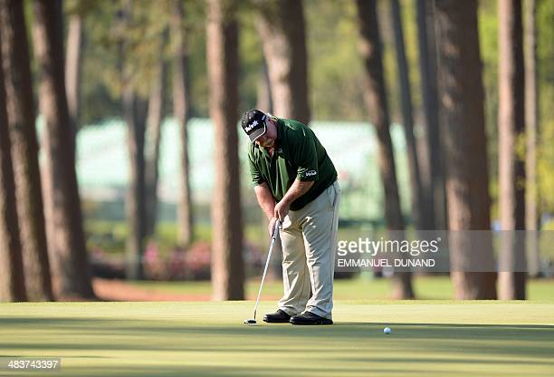 Craig Stadler of the US, putts during the first round of the 78th Masters Golf Tournament at Augusta National Golf Club on April 10, 2014 in Augusta,...