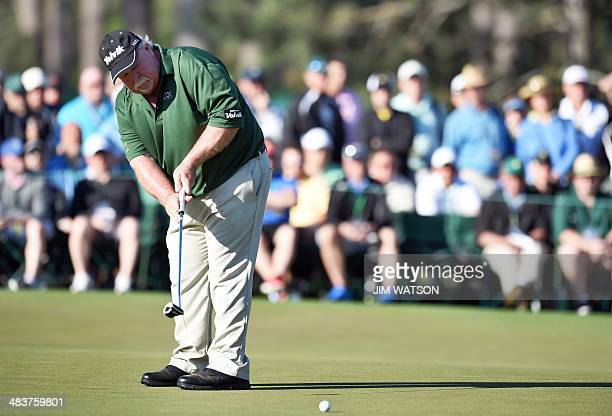 Craig Stadler of the US putts on the second green during the first round of the 78th Masters Golf Tournament at Augusta National Golf Club on April...