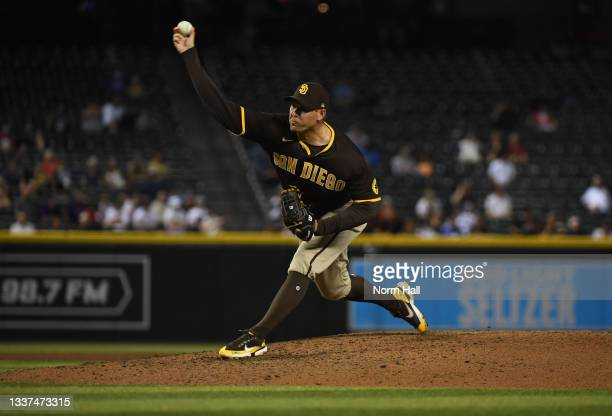 Craig Stammen of the San Diego Padres delivers a pitch against the Arizona Diamondbacks at Chase Field on August 30, 2021 in Phoenix, Arizona.