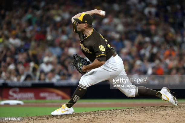 Craig Stammen of the San Diego Padres pitches during the eighth inning of a game against the San Francisco Giants at PETCO Park on July 26, 2019 in...