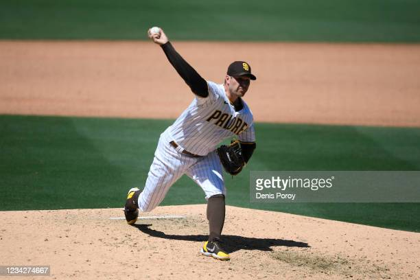 Craig Stammen of the San Diego Padres pitches during the sixth inning of a baseball game against the Oakland Athletics at Petco Park on July 28, 2021...
