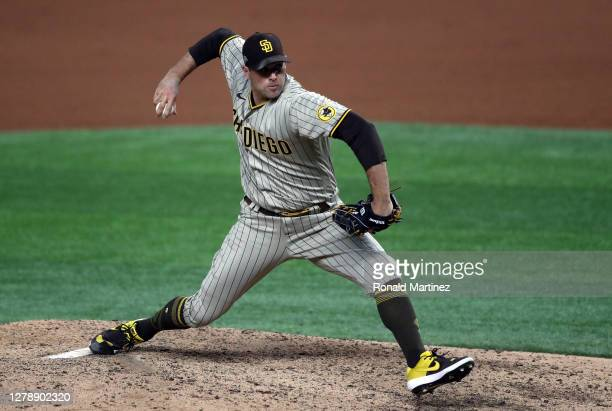 Craig Stammen of the San Diego Padres throws against the Los Angeles Dodgers in the seventh inning of Game One of the National League Division Series...