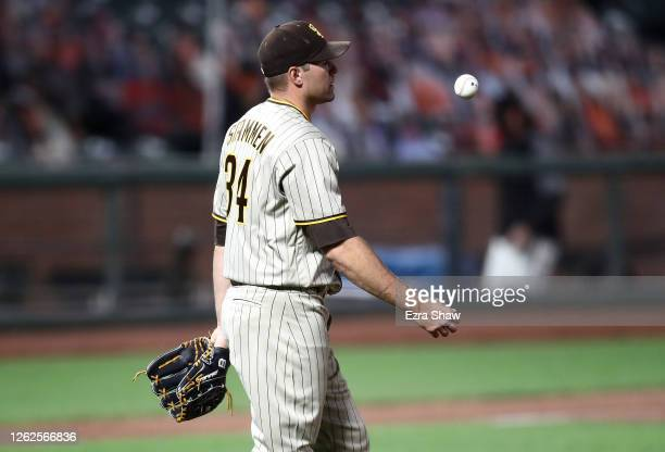 Craig Stammen of the San Diego Padres tosses the ball into the air after he gave up a three-run home run in the eighth inning to Donovan Solano of...