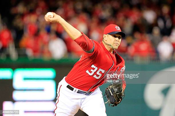Craig Stammen of the Washington Nationals throws a pitch in the thirteenth inning against the San Francisco Giants during Game Two of the National...