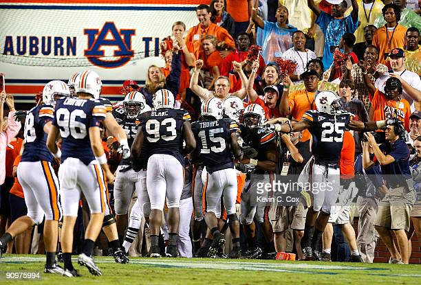 Craig Stevens of the Auburn Tigers celebrates his interception return for a touchdown in the final minutes of their 4130 win over the West Virginia...