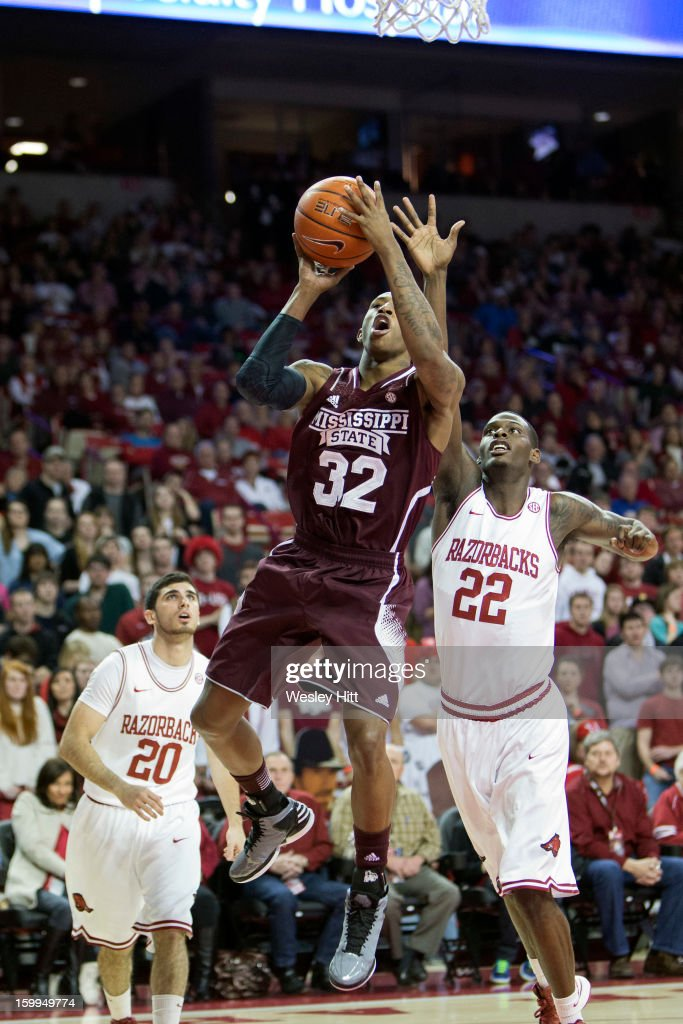 Craig Sword #32 of the MIssissippi State Bulldogs goes up for a shot against the Arkansas Razorbacks at Bud Walton Arena on January 23, 2013 in Fayetteville, Arkansas.