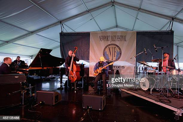 Craig Taborn Dave Holland Kevin Eubanks and Eric Harland of Dave Holland Prism perform during the 2014 Newport Jazz Festival at Fort Adams State Park...