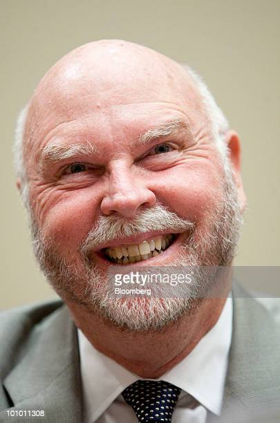 J Craig Venter chairman founder and chief executive officer of Synthetic Genomics Inc laughs during a House Energy and Commerce Committee hearing on...