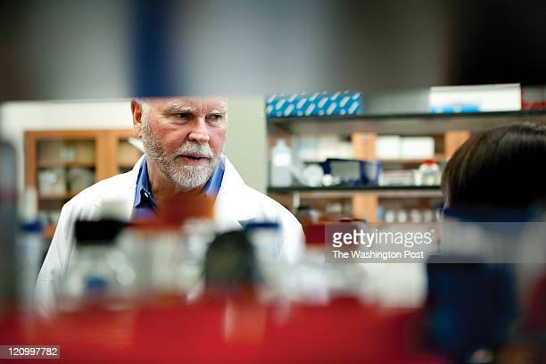 J Craig Venter talks with Li Ma the scientist who made the initial transfers at the J Craig Venter Institute