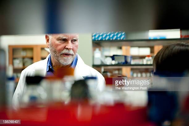 J Craig Venter talks with Li Ma the scientist who made the initial transfers of synthetic cell materials at the J Craig Venter Institute