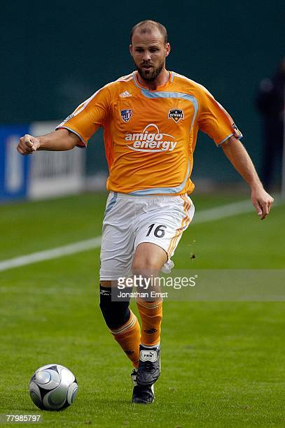 Craig Waibel of the Houston Dynamo handles the ball against the New England Revolution by a score of 21 to win the 2007 Major League Soccer Cup at...