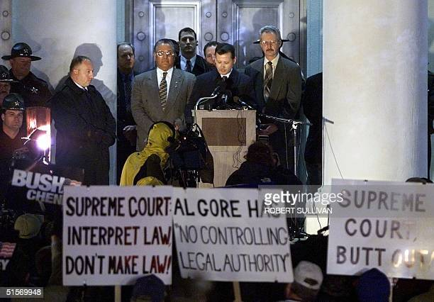 Craig Waters clerk of the Florida Supreme Court reads a statement from the court 21 November 2000 in Tallahassee Florida The Court ruled that manual...