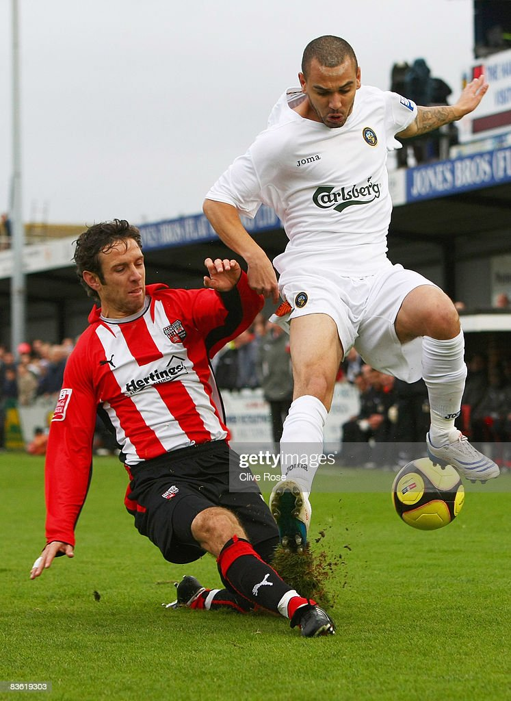 Craig Watkins of Havant & Waterlooville is challenged by Alan Bennet of Brentford during the FA Cup 1st Round match between Havant & Waterlooville and Brentford at the Westleigh Park on November 9, 2008 in Havant, England.