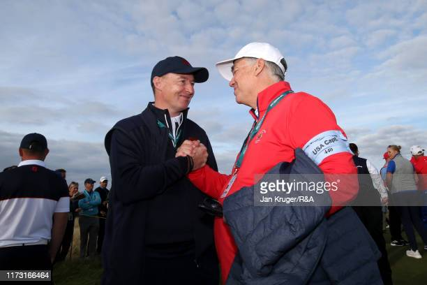 Craig Watson, Team Captain of Great Britain and Ireland and Nathaniel Crosby, Team Captain of the United States embrace after the singles matches...
