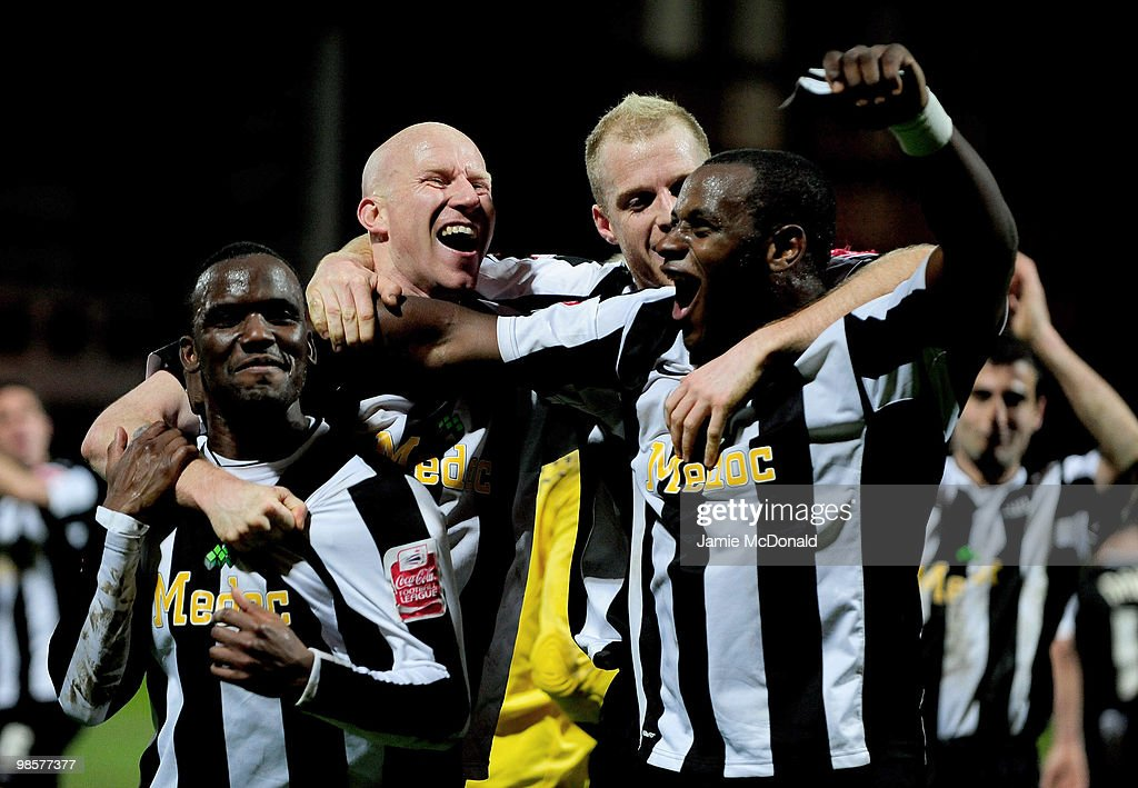 Craig Westcar, Lee Hughes, Neal Bishop and Delroy Facey of Notts County celebrate victory at the close of the Coca Cola League 2 match between Notts County and Rochdale at the Meadow Lane Stadium on April 20, 2010 in Nottingham, England.