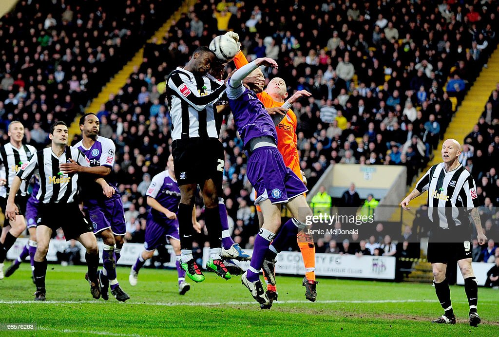 Craig Westcarr of Notts County jumps for the ball with Nathan Stanton; Graig Jones and Frank Fielding of Rochdale during the Coca Cola League 2 match between Notts County and Rochdale at the Meadow Lane Stadium on April 20, 2010 in Nottingham, England.