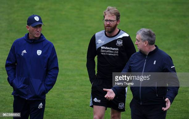 Craig White First Team Coach of Hampshire Richard Dawson Head Coach of Gloucestershire and Umpire Paul Pollard chat as the match is abandoned without...