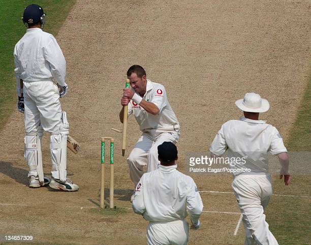Craig White of England uproots a souvenir stump after dismissing Ashish Nehra the last man for India during the 1st Test between England and India at...