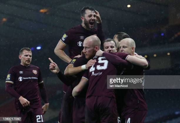 Craig Wighton of Heart of Midlothian celebrates with teammates after scoring his team's first goal during the William Hill Scottish Cup first...